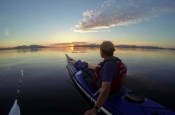 Nick Ray sea kayaking at sunset